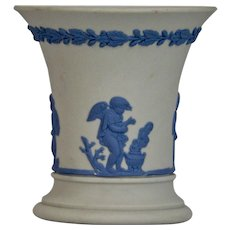 Wedgwood White Jasper-ware White Small Vase, with moulded blue applied putti's details.