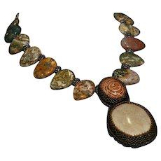 Breathtaking Ocean Jasper, fossilized Dinosaur Bone and Quartz statement necklace
