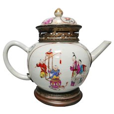A teapot with stand/ incense burner