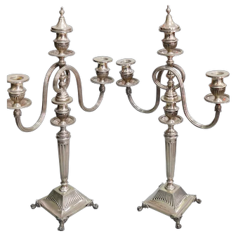 A pair portuguese silver three-light candelabra.