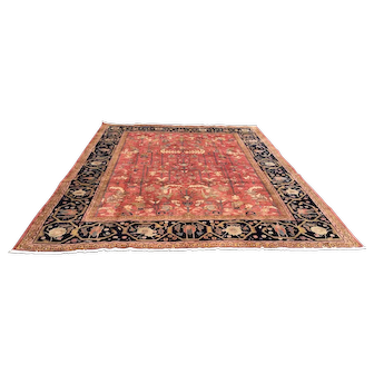 "Persian carpet, Vintage  Heriz. C1930, 11'3"" x 8'3"". Peach colored field with all over Lilly pattern. Midnight blue border."