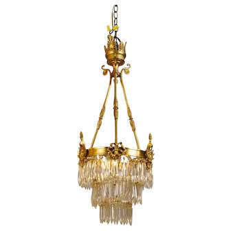 Circa 1920, French Gilt Brass and Bronze Crystal Chandelier