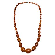 "Vintage Butterscotch Amber Bakelite 29"" Graduated Bead Necklace"