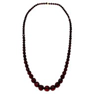 "Red Cherry Amber Bakelite 28.5"" Faceted Graduated Bead Necklace"