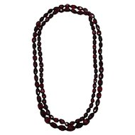 """Red Cherry Amber Bakelite 44.5"""" Faceted Graduated Bead Necklace"""