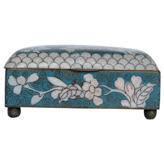 Circa 1900, cloisonné box, bright blue with white floral accents.