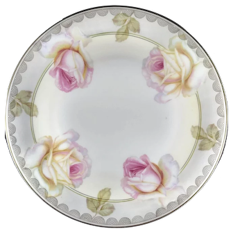 porcelain serving plate, Marked with castle and PV on the back