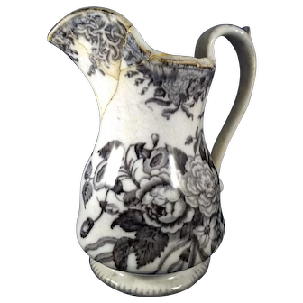 Pitcher with black and white  floral painting
