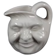 Creamer 2.5 inches high, man in the moon face, white glaze