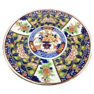 Oriental plate 6.5 inches in diameter.
