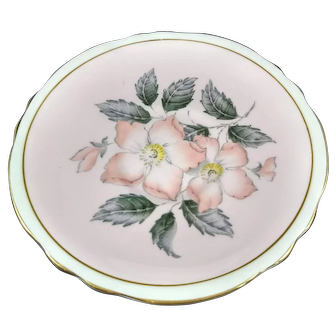 5.5 inch diameter saucer.  Marked Paragon Fine Bone China England