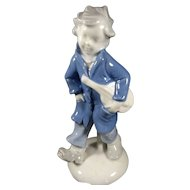 A boy and his violin Figurine , marked GEROLD