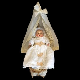 Lovely Composition Baby Doll in her Layette and Wicker Crib