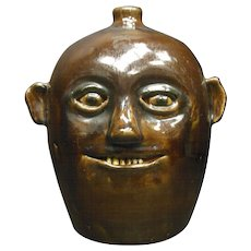 Reggie Meaders Southern Folk Pottery Brown Handled Face Jug