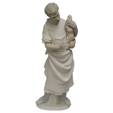 Antique Lladro Statuette of Obstetrician with Newborn Baby