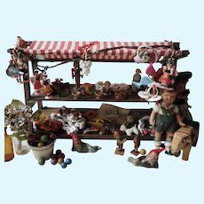 Vintage german miniature doll´s market stood with awning and filled with toys  Octoberfest