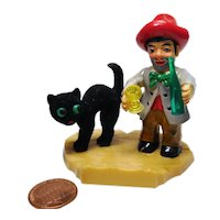 Vintage German flocked black cat with drunken man figurine