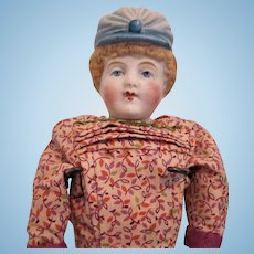 Bonnet head German bisque doll