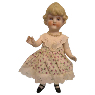 Antique German all bisque 7 inch with dress