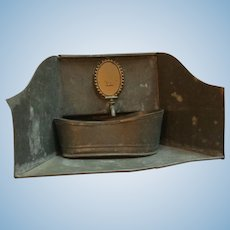 Early 1900's toy tin bath with water tank