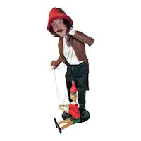 Byers Choice Caroler Puppeteer holding Pinocchio