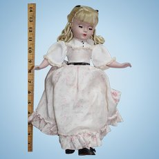 """Madame Alexander """"Amy"""" from Little Women. 1948-1950, Floss hair. Original clothing."""
