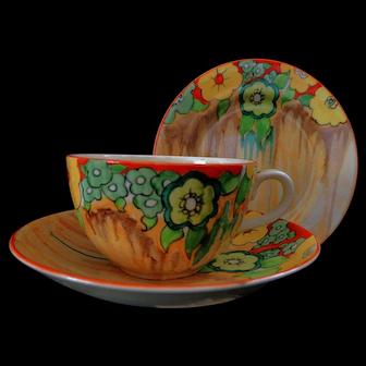 "An Original Clarice Cliff Globe ""Jonquil"" Tea Size Trio"