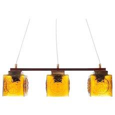 AMBER GLASS hanging light-fixture, 1960s. Scandinavian mid-century design. Attractive light fixture w. 3 glass shades, brass & teak crossbar