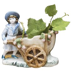 Charming French vintage porcelain figurine Girl with small cart