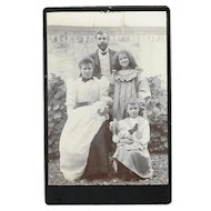 Cabinet photo Family group 1 child holding doll early 20th century