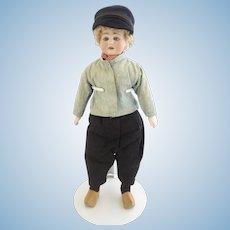 "Bisque shoulder plate head Dutch Boy doll 14"" tall original cloths late 19th/early 20th century"
