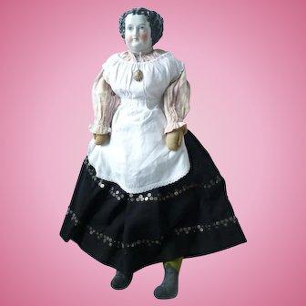 Unusual and large glazed china shoulder head doll German circa 1850