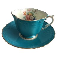 Aynsley 1950s fluted cup with flowers on the interior and a scalloped saucer