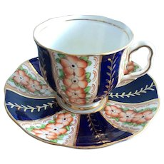 Royal Albert puffy lightly fluited and scalloped cup and saucer
