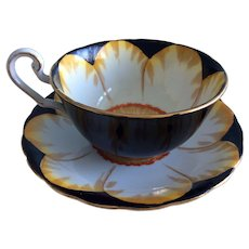 Black Victoria hand painted cup and saucer