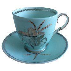 Paragon demitasse cup and saucer featuring unusual silver art and trim