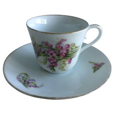 Limoges white demitasse cup and saucer with purple flowers