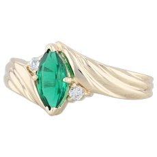 .65ctw Synthetic Emerald & Diamond Ring - 10k Yellow Gold Size 6.25 Bypass Band