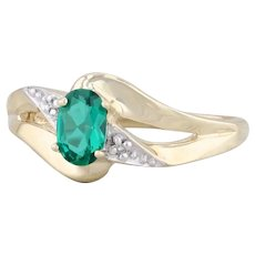 0.30ctw Synthetic Emerald Bypass Ring 10k Yellow Gold Size 7 Diamond Accents