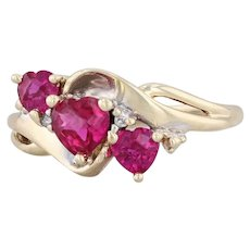 1.31ctw Synthetic Ruby Heart Ring 10k Yellow Gold 7 Diamond Accents Bypass Band