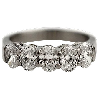 Vintage Platinum and Oval Diamond Wedding Band