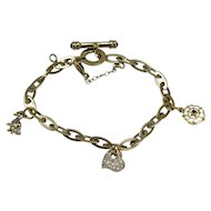 Vintage 18 Carat Roberto Coin Diamond Sapphire Enamel and Ruby Charm Bracelet