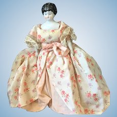 Delicate petite china head doll
