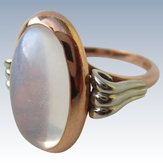 Moonstone ring, set in 14 kt pink and white gold, Deco style