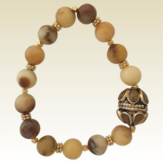 Yellow agate beads with brass focal bead on elastic