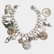 Vintage Charm Bracelet Sterling Silver Loaded With 19 Charms Including a Capitol Record Album and a Jade Charm