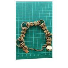 Vintage Miriam Haskell gold tone filigree and jade rings bracelet