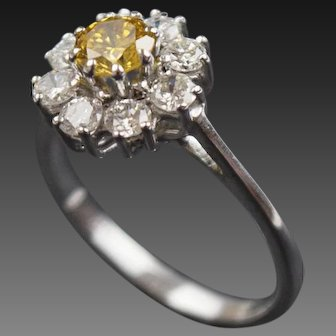 Yellow and White Diamond cluster ring in 18ct white gold.