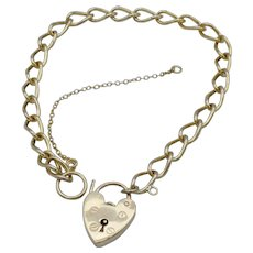 Vintage, 9ct Gold, Curb link bracelet with Padlock clasp and safety chain.