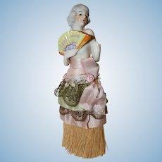 """8 ½"""" Vintage Half Doll on Broom."""